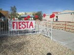 Fiesta sign on a fench