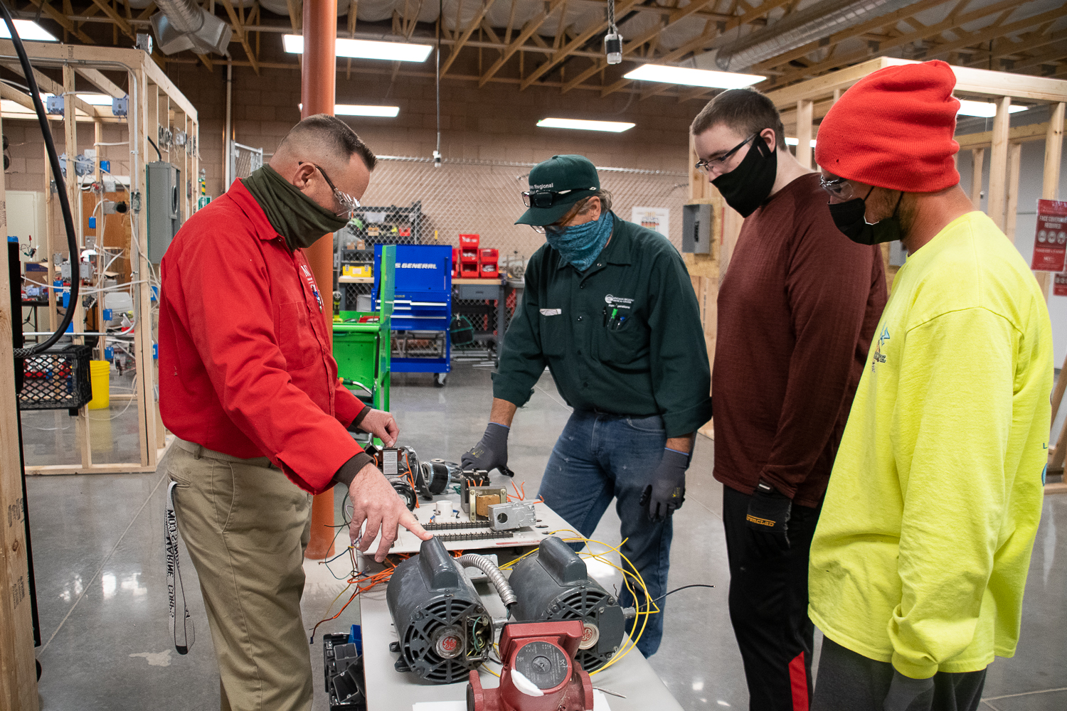 MCC Electrical Technology Instructor Michael McKenzie (left) teaching students on the Neal Campus in Kingman.  Electrical Technology is one of many skilled trades that would be based out of the new Advanced Manufacturing Training Center.