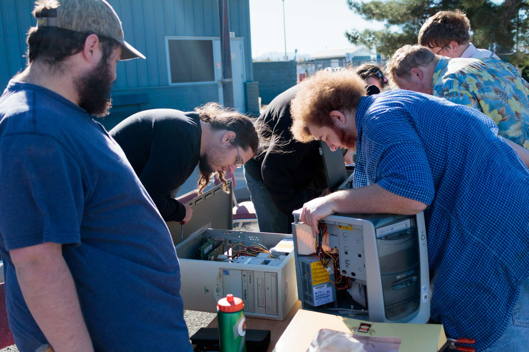 students taking apart computers at Tech Recycle drive 2017